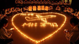 Chinese Hold Vigil for MH370 Passengers