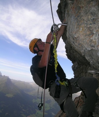 Climber_on_fixed_rope_route_Piz_Mitgel_1